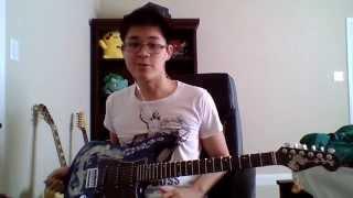 Playing a Vietnamese guitar