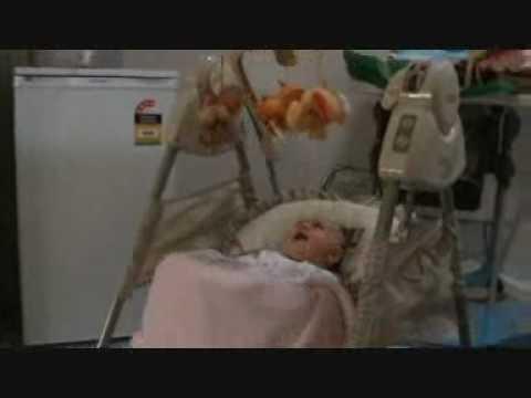 Baby in her swing