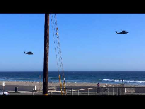 Private Helicopters Flying Low Above Zuma Beach, Malibu CA.