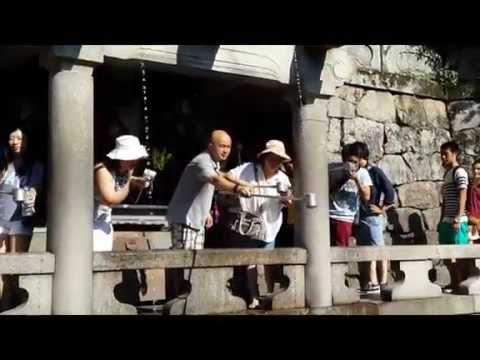 Drinking the Holy Water from Otowa Waterfall at Kiyomizudera Temple in Kyoto, Japan