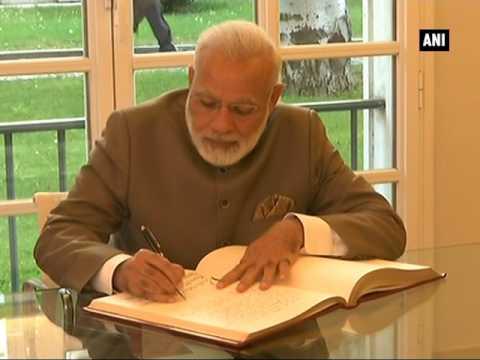 Watch: PM Modi signs book of honour at Madrid palace - ANI News