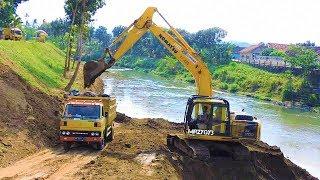 Gambar cover River Sedimentation Clearing By Komatsu PC200 Excavator And Dump Trucks
