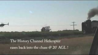 UP # 844 races a Helicopter-History Channel-Extreme Trains