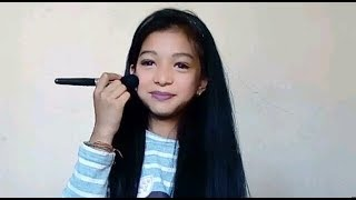 11 years old girl does her makeup