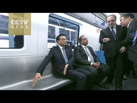 Chinese Premier Li Keqiang rides a made-in-China subway in Brazil