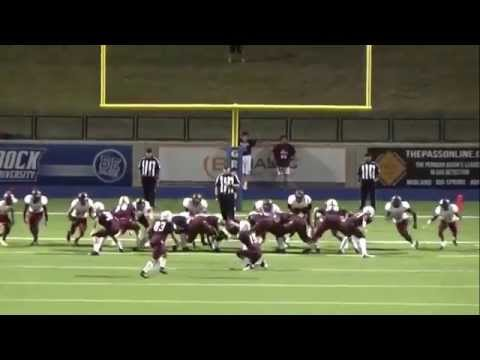 High School football player kicks a field goal off of the referees head
