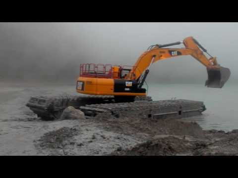 EIK AM350 Amphibious Excavator Action in Grasberg  The Largest Gold Mine in the World