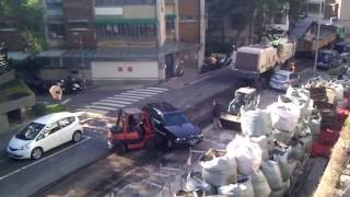 BMW getting moved by construction crew