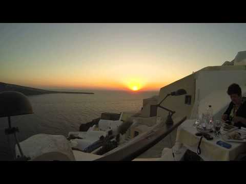 Beautiful Sunset Dinner in town of Oia on the Greek Island of Santorini.