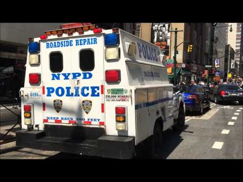 RARE CATCH OF THE NYPD ROADSIDE REPAIR UNIT TENDING TO A BROKEN DOWN UNMARKED POLICE CRUISER IN NYC.