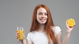 Girl Holding Glass of Orange Juice and Laughing at Camera | Stock Footage - Videohive