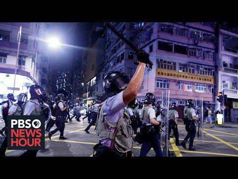 Hong Kong's divide: Protests for democracy, rally for China