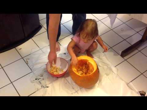 15.10.27 Charlie Cleaning Out Her Pumpkin