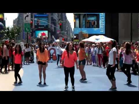 Life Vest Inside Flash MOB - Times Square - Wavin' Flag by K'naan