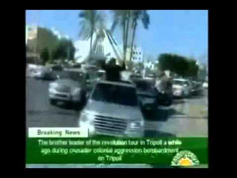 Gaddafi motorcade in Tripoli under NATO and rebels attacks - Libya state TV