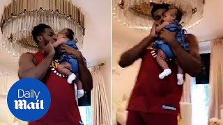 Tristan Thompson on daddy duty dancing with baby True Thompson - Daily Mail