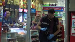 pompalı tüfekle markete gelen öğretmen market sahibini vurarak ağır yaraladı.