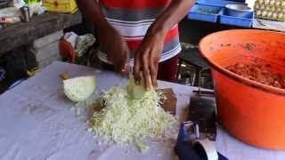 fast cabbage cutting and slicing by Indian street food vendor knife skills JULIENNE