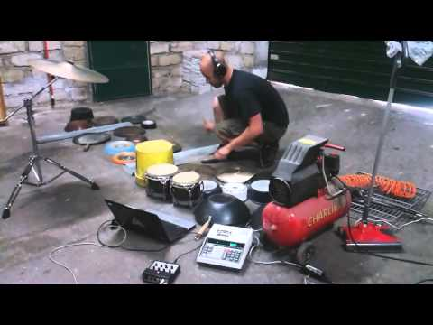 Performer uses garage items to create music