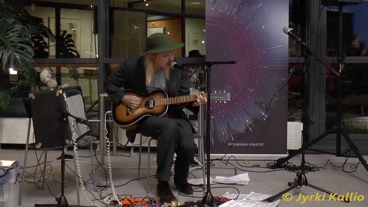 Jukka Nousiainen - Hyllyjen välissä rock 'n' roll (video Jyrki Kallio) - YouTube