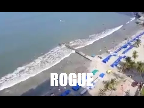 "Rogue wave baffles tourists as a ""Mini Tsunami"" overtakes the entire beach!"