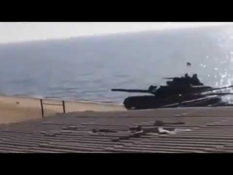 Ukrainian tank patrols the coast of the Azov Sea