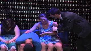Hypnotized girl freaks out at hypnotist while on stage in Las Vegas!