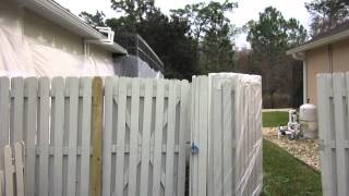 Fence painting in Hunters Creek