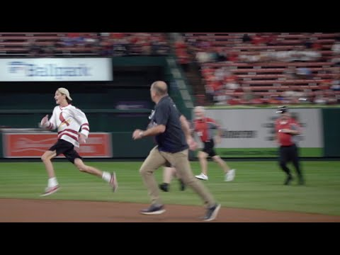 Crazy Fan Running On The Field At Busch Stadium