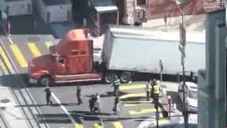 Semi truck gets hung up on steep street in San Francisco