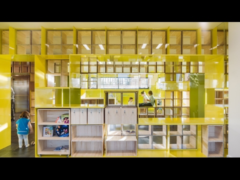 Walls with integrated furniture and yellow nooks encourage p