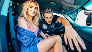 Handcuffed Together In A Police Car