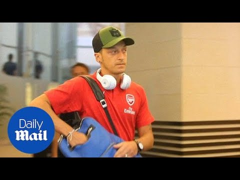 Mesut Ozil arrives in Singapore after quitting Germany over racism