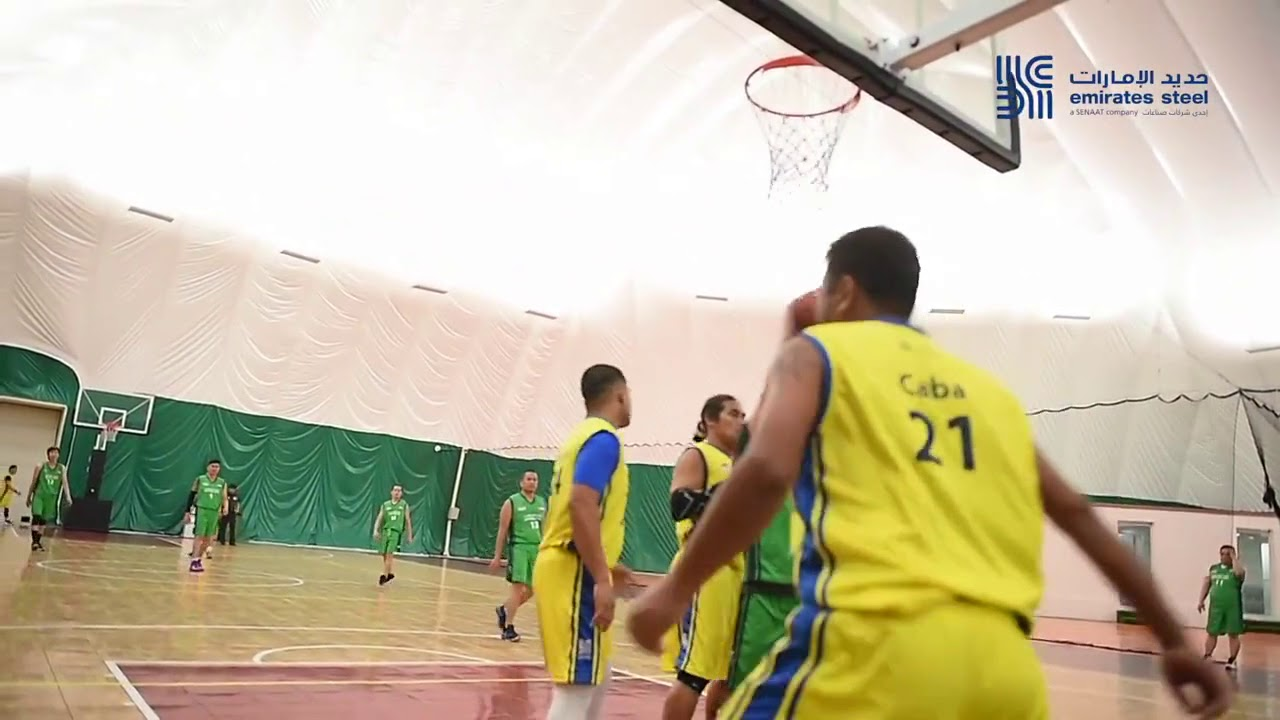 Emirates Steel employees participating in the internal basketball final  match at Al Forsan Club