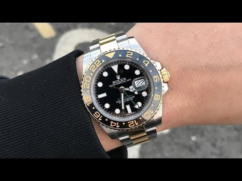 Rolex GMT-Master II 116713LN black dial 40 mm two tone steel and yellow gold luxury watch on wrist