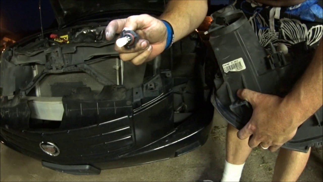 how to replace headlight assembly and change headlight bulb on cadillac cts 03 07 [ 1280 x 720 Pixel ]
