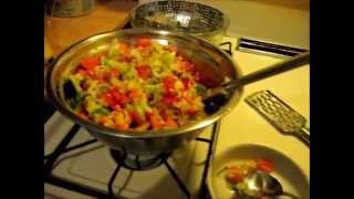 Summer Salad Using Red Orange Yellow Peppers Celery Onions Cucumbers With Vinegar & Oil Dressing