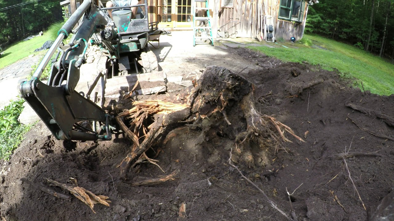 Digging Out Stumps With A Mini Excavator