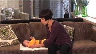 Miten vauva nostetaan syliin tai lasketaan hoitopöydälle