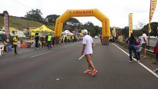 Bongumusa Mthembu passing Pinetown with a group of runners