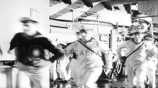 Nazi planes follow a German battleship in the Atlantic Ocean. HD Stock Footage