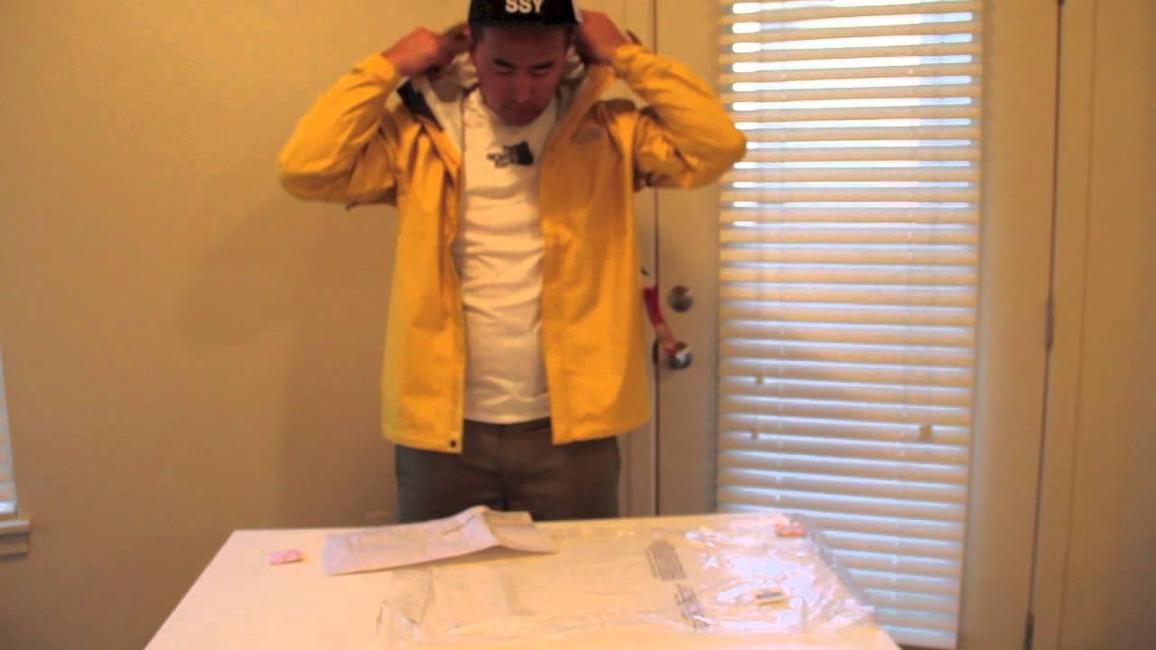 Yellow north face rain jacket mens