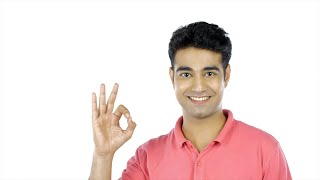 Closeup shot - Attractive Indian guy showing ok symbol while looking into the camera