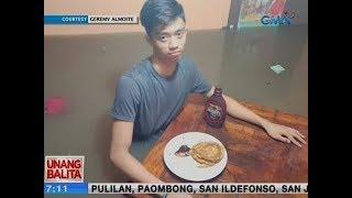 UB: Lalaking kumakain ng pancake habang nakalubog sa baha, viral