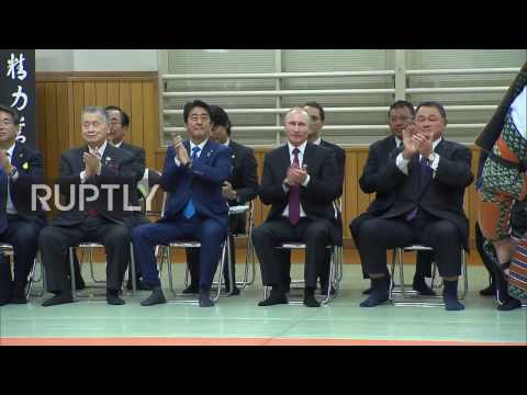 Japan: Putin and Abe watch judo display in Tokyo
