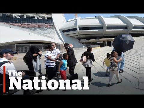 Montreal's Olympic Stadium turned into home for asylum seekers from the U.S.