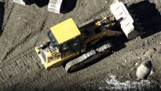 Caterpillar 963C track loader working in a foundation