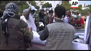Burial team counts grim toll of Libyan conflict