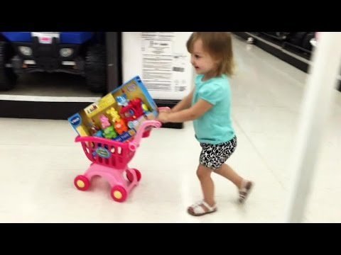"""Cute Little Girl Doing Shopping 