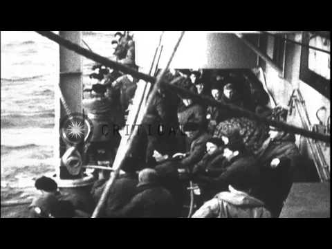 Battleship USS South Dakota (BB-57) in rough seas of Pacific Ocean and rescue at ...HD Stock Footage
